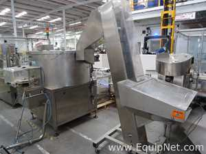 Tover Industria Argentina OEF Bottle Orienter with Stainless Steel Inclined Elevator Conveyor