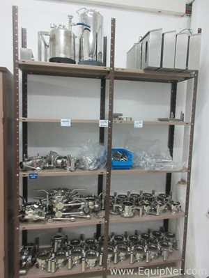 Shelving Unit with Lot of Stainless Steel Butterfly Valves and Tote Connectors